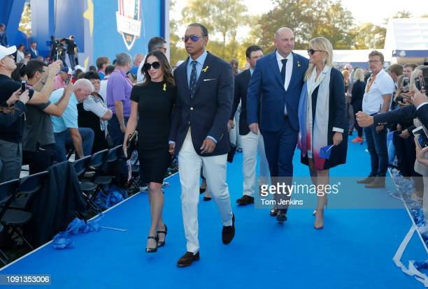 Tiger Woods and his girlfriend Erica Herman walk out of the opening ceremony next to Thomas Bjorn and his girlfriend Grace Barber ahead of the 2018...