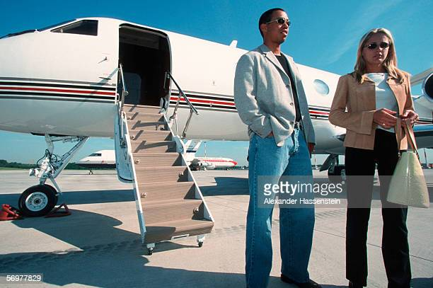 Tiger Woods and his girlfriend Joanna Jagoda are seen arriving at Hamburg International airport on May 16 2000 in Hamburg Germany