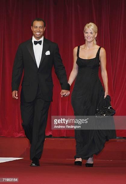 Tiger Woods and his wife Elin walk down the catwalk during the Ryder Cup Gala Dinner at Citywest Hotel and Golf Resort September 20 2006 in Dublin...