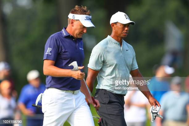 Tiger Woods and Ian Poulter of England walk up to the 7th green during the third round of The Northern Trust on August 25, 2018 at the Ridgewood...