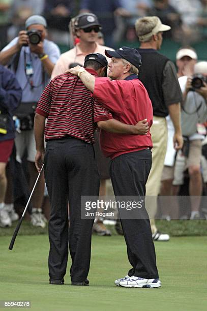 Tiger Woods and Jack Nicklaus captain of the US team talk during the fourball matches in the third round of The Presidents Cup at Robert Trent Jones...