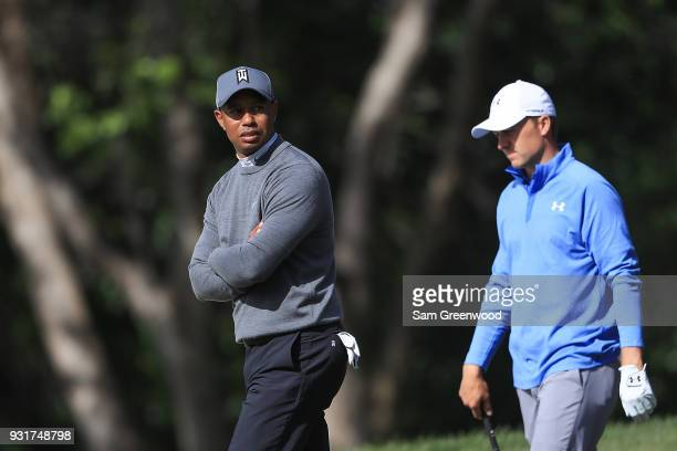 Tiger Woods and Jordan Spieth look on on the 11th hole during the first round of the Valspar Championship at Innisbrook Resort Copperhead Course on...