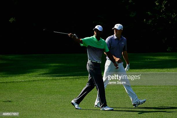 Tiger Woods and Jordan Spieth of the United States walk together during a practice round prior to the start of the 2015 Masters Tournament at Augusta...