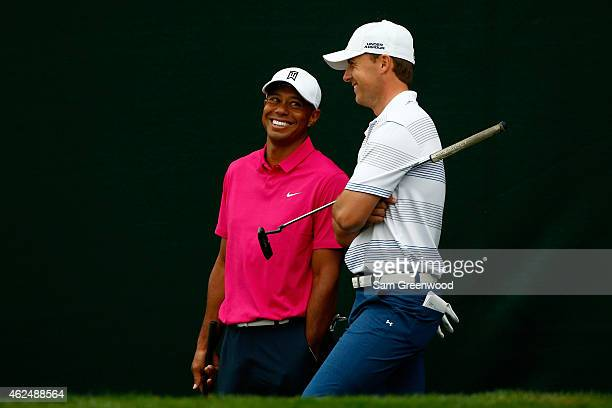 Tiger Woods and Jordan Spieth talk together on the 17th hole during the first round of the Waste Management Phoenix Open at TPC Scottsdale on January...