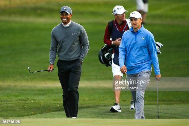 Tiger Woods and Jordan Spieth walk up the 17th hole fairway during the first round of the Valspar Championship at Innisbrook Resort Copperhead Course...