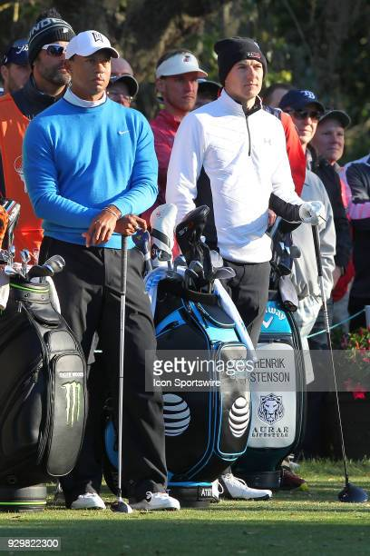 Tiger Woods and Jordan Spieth watch Henrik Stenson tee off on the 11th hole during the first round of the Valspar Championship on March 09 at Westin...