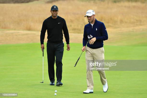 Tiger Woods and Justin Thomas both of United States play a practice round during previews ahead of the 147th Open Championship at Carnoustie Golf...