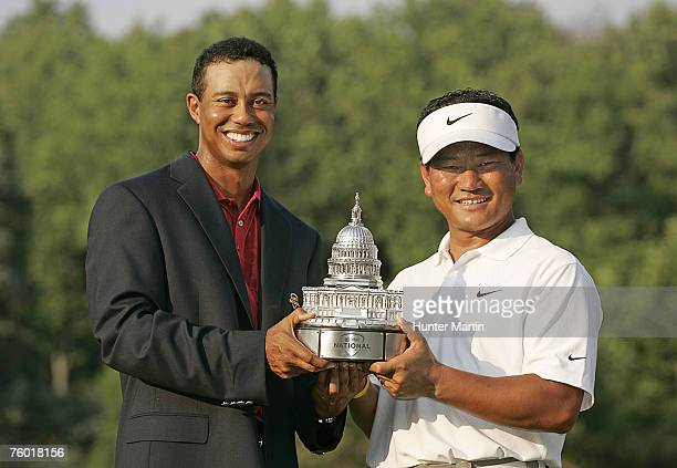 Tiger Woods and KJ Choi with the championship trophy after the final round of the ATT National at Congressional Country Club on July 8 2007 in...
