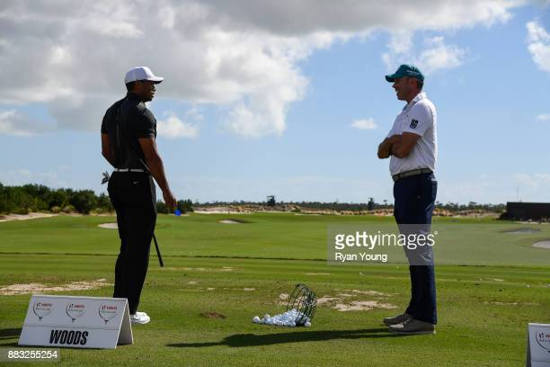 Tiger Woods and Matt Kuchar talk on the range during the first round of the Hero World Challenge at Albany course on November 30 2017 in Nassau...