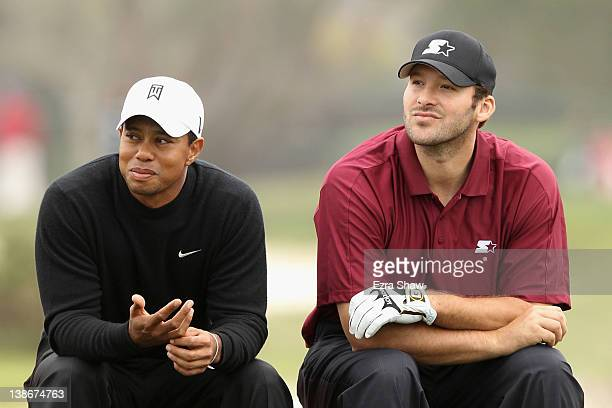 Tiger Woods and NFL football quarterback for the Dallas Cowboys Tony Romo wait on the sixth tee during the second round of the ATT Pebble Beach...