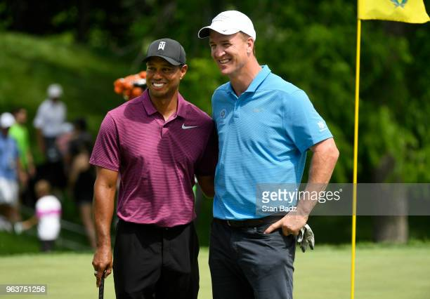 Tiger Woods and Peyton Manning pose for a photo on the 18th green after their ProAm round prior to the Memorial Tournament presented by Nationwide at...