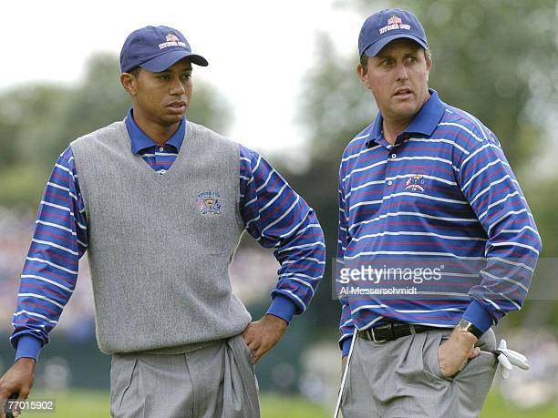 Tiger Woods and Phil Mickelson wait for play during fourball competition at the 2004 Ryder Cup in Detroit Michigan September 17 2004