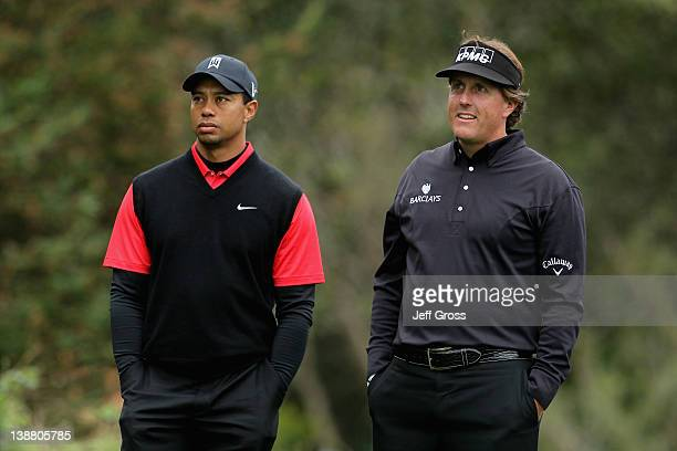 Tiger Woods and Phil Mickelson wait on the second tee during the final round of the ATT Pebble Beach National ProAm at Pebble Beach Golf Links on...