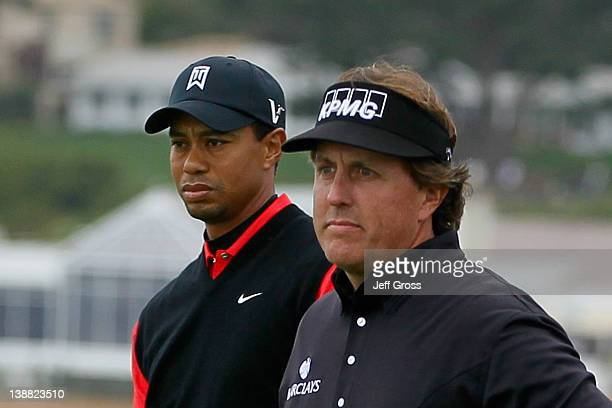 Tiger Woods and Phil Mickelson wait on the seventh hole tee during the final round of the ATT Pebble Beach National ProAm at Pebble Beach Golf Links...