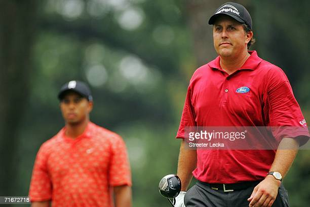 Tiger Woods and Phil Mickelson walk off of the first tee box after starting their round during the second round of the 2006 PGA Championship at...