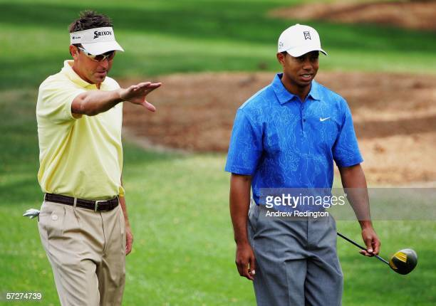 Tiger Woods and Robert Allenby of Australia walk down the third fairway during the second round of The Masters at the Augusta National Golf Club on...