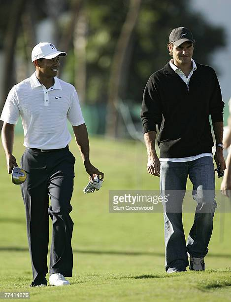 Tiger Woods and Roger Federer during a practice round at the CA Championship held at the Doral Resort and Spa on the Blue Monster Course in Miami,...