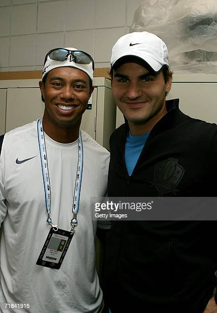Tiger Woods and Roger Federer pose before Federer's match against Andy Roddick in the men's final of the US Open at the USTA Billie Jean King...