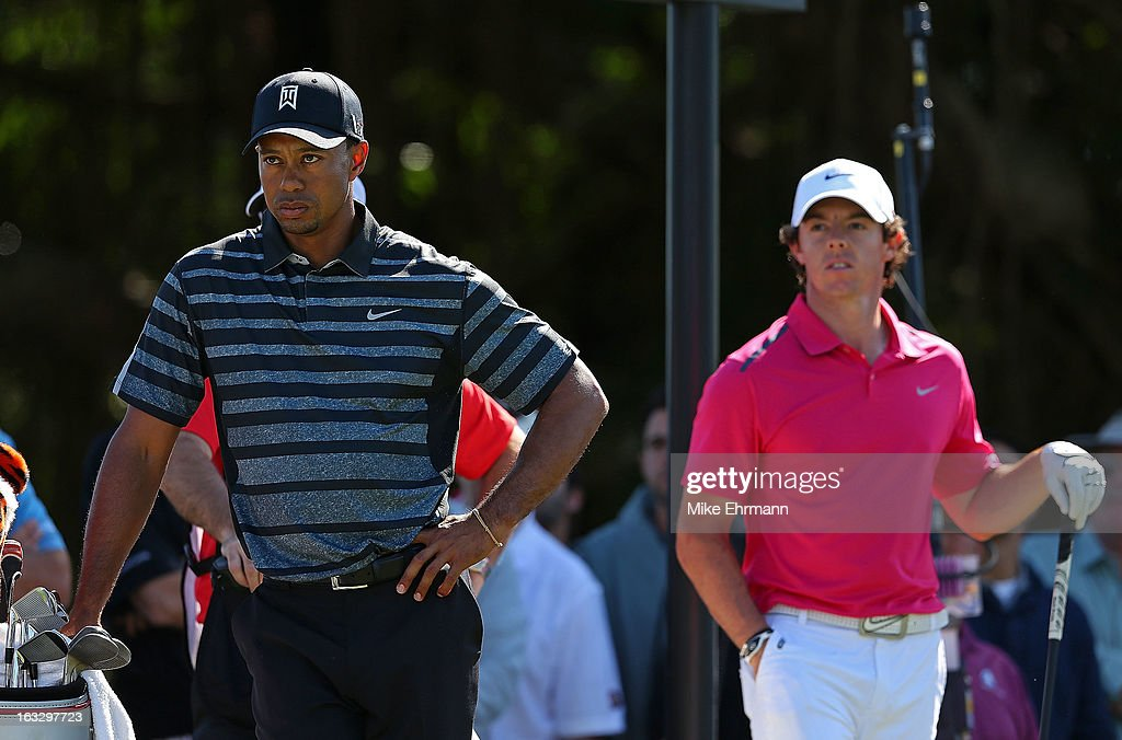 Tiger Woods and Rory McIlroy from Northern Ireland wait to hit their tee shot on the sixth hole during the first round of the WGC-Cadillac Championship at the Trump Doral Golf Resort & Spa on March 7, 2013 in Miami, Florida.