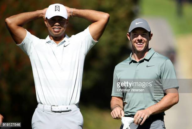 Tiger Woods and Rory McIlroy of Northern Ireland meet at the fourth tee during the second round of the Genesis Open at Riviera Country Club on...