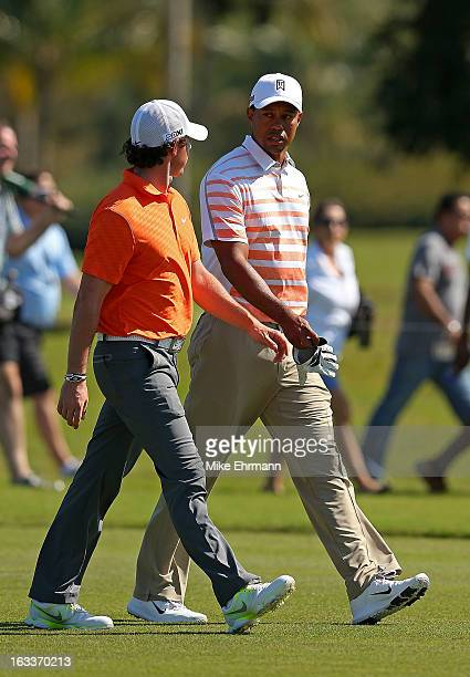 Tiger Woods and Rory McIlroy of Northern Ireland talk on the sixth hole during the second round of the WGCCadillac Championship at the Trump Doral...