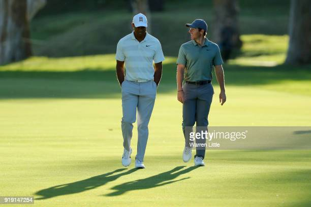 Tiger Woods and Rory McIlroy of Northern Ireland walk across the 17th hole during the second round of the Genesis Open at Riviera Country Club on...
