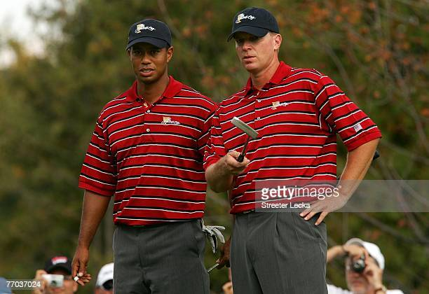 Tiger Woods and Steve Stricker of the U.S. Team look over the 11th green during practice prior to the start of The Presidents Cup at The Royal...