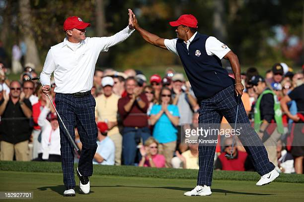 Tiger Woods and Steve Stricker of the USA celebrate winning the 11th hole during the Afternoon Four-Ball Matches for The 39th Ryder Cup at Medinah...