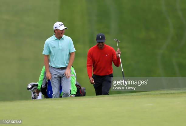 Tiger Woods and Tom Hoge walk up the fairway during the final round of the Farmers Insurance Open at Torrey Pines South on January 26, 2020 in San...