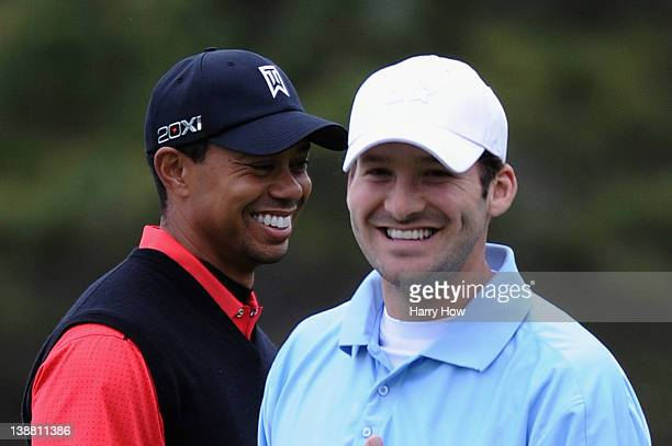 Tiger Woods and Tony Romo NFL football quarterback for the Dallas Cowboys share a laugh on the fifth hole during the final round of the ATT Pebble...