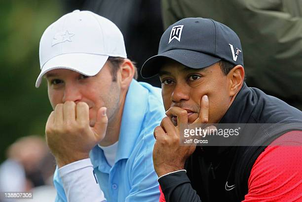 Tiger Woods and Tony Romo NFL football quarterback for the Dallas Cowboys wait on the second tee box during the final round of the ATT Pebble Beach...