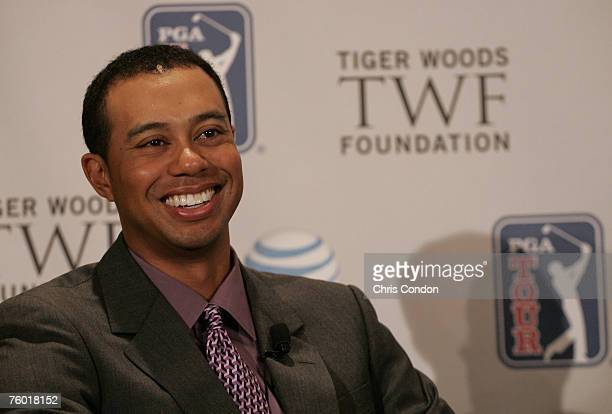 Tiger Woods answers questions from the media at a press conference announcing a new PGA TOUR event called the AT&T National, at the National Press...