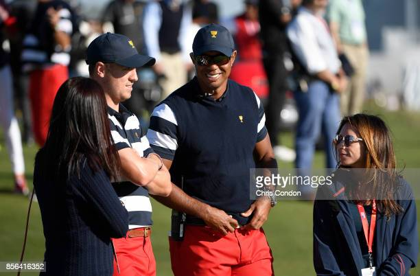 Tiger Woods Captains Assistant of the US Team and Erica Herman talk with Justin Thomas of the US Team play during the Sunday singles matches at the...