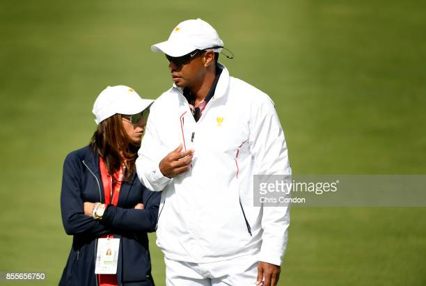 Tiger Woods Captains Assistant of the US Team and girlfriend Erica Herman on the course during the second round of the Presidents Cup at Liberty...