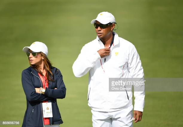 Tiger Woods, Captains Assistant of the U.S. Team, and girlfriend Erica Herman on the course during the second round of the Presidents Cup at Liberty...