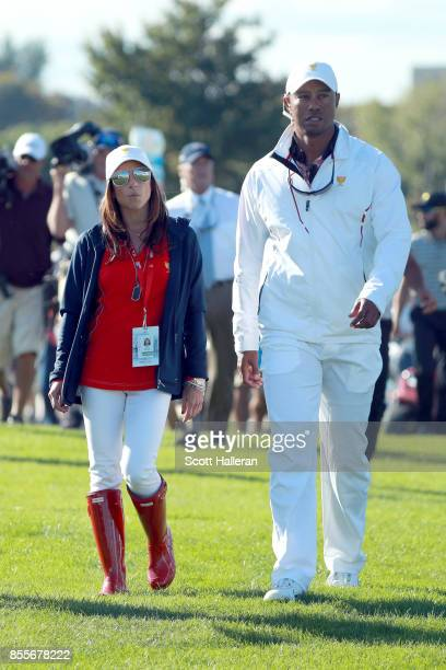 Tiger Woods Captains Assistant of the US Team and girlfriend Erica Herman walk together during the second round of the Presidents Cup at Liberty...