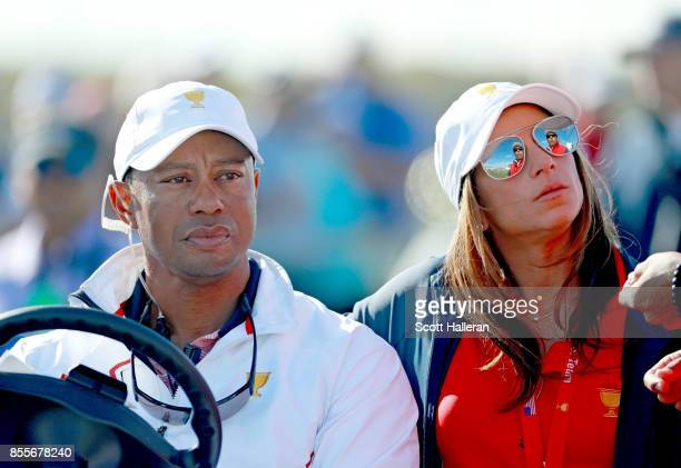 Tiger Woods Captains Assistant of the US Team and girlfriend Erica Herman sit together during the second round of the Presidents Cup at Liberty...
