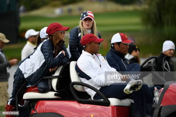 Tiger Woods Captains Assistant of the US Team and girlfriend Erica Herman watch the action during the afternoon fourball matches at the Presidents...