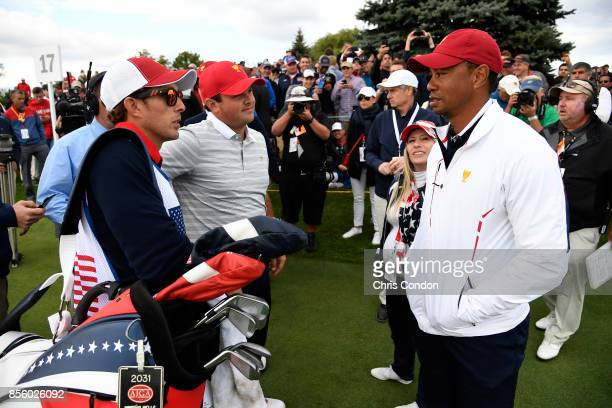 Tiger Woods Captains Assistant of the US Team speaks with the team during the afternoon fourball matches at the Presidents Cup at Liberty National...