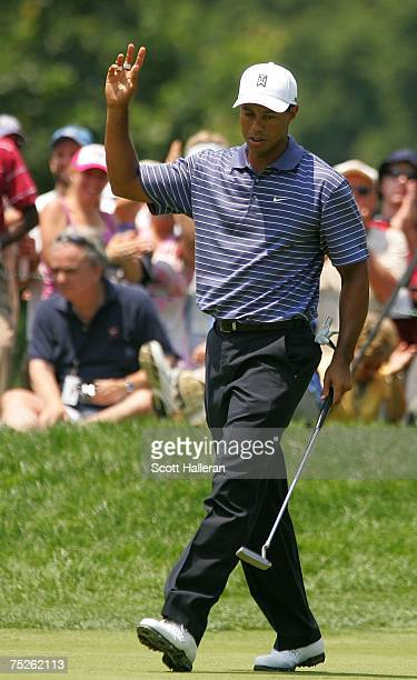 Tiger Woods celebrates a birdie on the first green during the third round of the ATT National at Congressional Country Club on July 7 2007 in...
