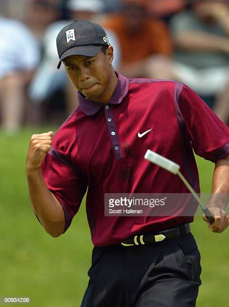 Tiger Woods celebrates a birdie on the fourth green during the final round of The Memorial Tournament at Muirfield Village Golf Club on June 6 2004...