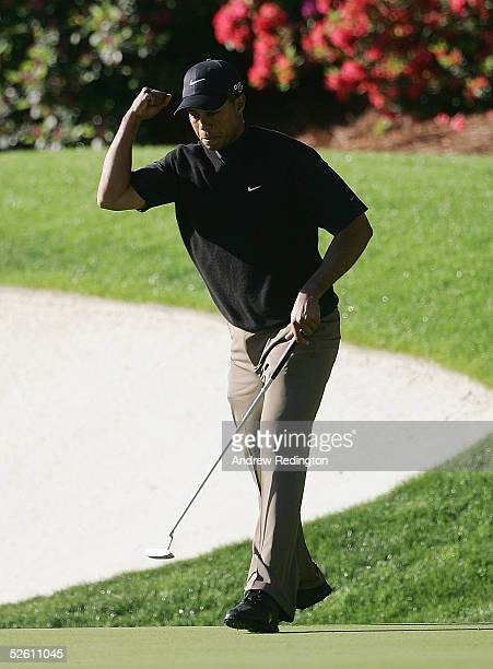 Tiger Woods celebrates a birdie putt on the 13th green during the third round of The Masters at the Augusta National Golf Club on April 10 2005 in...