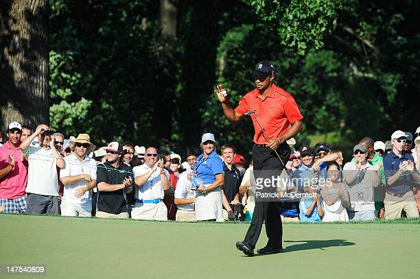 Tiger Woods celebrates a birdie putt on the 15th hole during the Final Round of the ATT National at Congressional Country Club on July 1 2012 in...