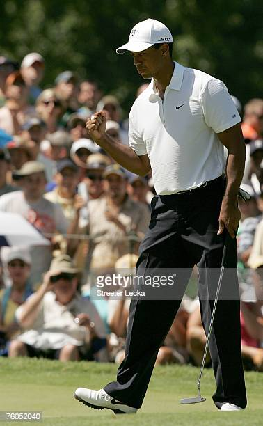 Tiger Woods celebrates a birdie putt on the fifth hole during the second round of the 89th PGA Championship at the Southern Hills Country Club on...
