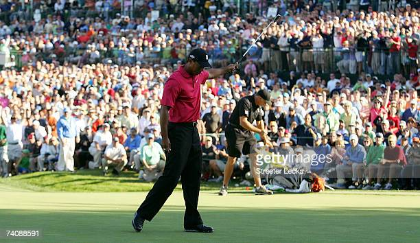 Tiger Woods celebrates after his two-stroke vicotory at the Wachovia Championship at Quail Hollow Club on May 6, 2007 in Charlotte, North Carolina.