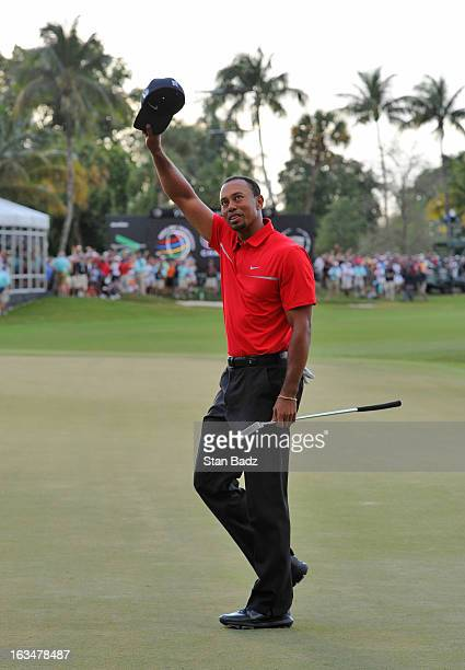 Tiger Woods celebrates after his twostroke victory during the final round of the World Golf ChampionshipsCadillac Championship at TPC Blue Monster at...