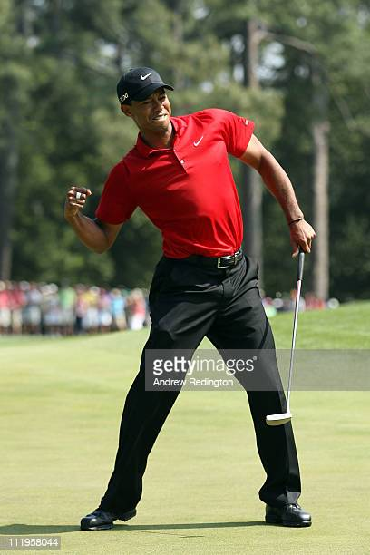 Tiger Woods celebrates after holing a putt for eagle on the eighth green during the final round of the 2011 Masters Tournament on April 10 2011 in...