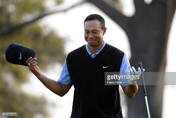 Tiger Woods celebrates after holing out from the rough for birdie on the 17th hole during the third round of the 108th US Open at the Torrey Pines...