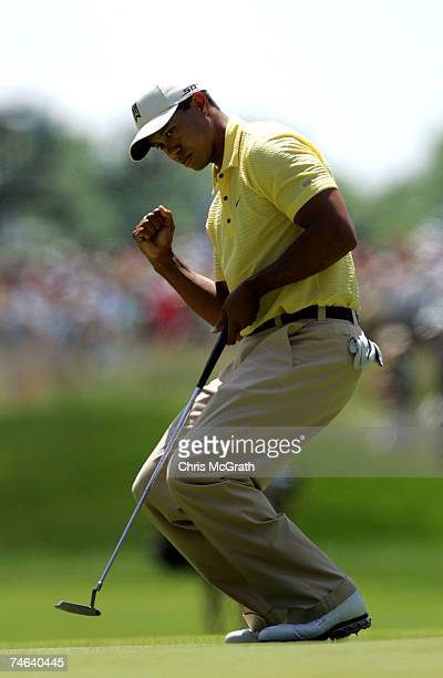 Tiger Woods celebrates after making a birdie on the 12th hole during the second round of the 107th U.S. Open Championship at Oakmont Country Club on...