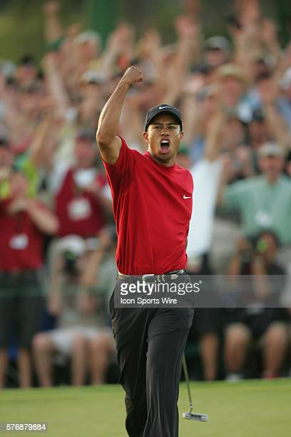 Tiger Woods celebrates after making a birdie putt at No 18 in the first hole of a suddendeath playoff to win The Masters his fourth and ninth major...